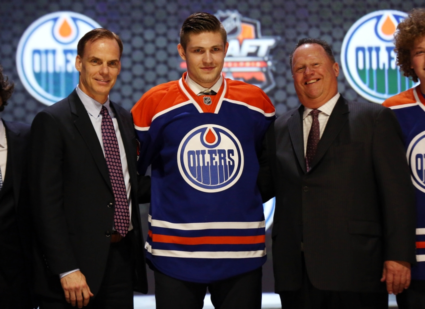 Jun 27, 2014; Philadelphia, PA, USA; Leon Draisaitl poses for a photo with team officials after being selected as the number three overall pick to the Edmonton Oilers in the first round of the 2014 NHL Draft at Wells Fargo Center. Mandatory Credit: Bill Streicher-USA TODAY Sports